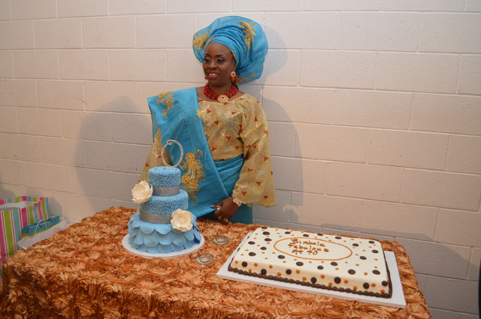The celebrant and the cakes