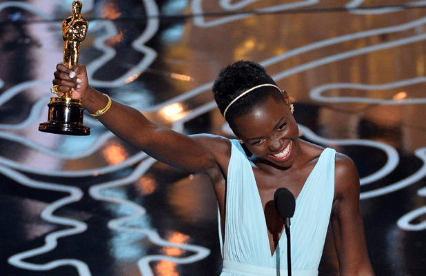 Lupita Nyong'o accepting her Best Supporting Actress award at the Academy Awards for 12 Years A Slave